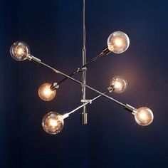 NEW FINISH! Angled and adjustable. Our Mobile Chandelier adds intrigue to a space, with its contemporary shape and adjustable arms. Made of metal in a polished nickel finish, it dazzles when paired with clear, oversized bulbs.