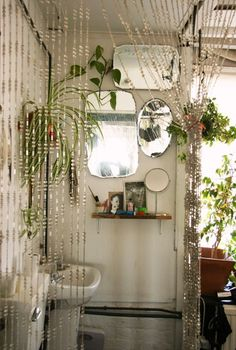 Bathroom with Bead Curtain and trio of vintage mirrors.