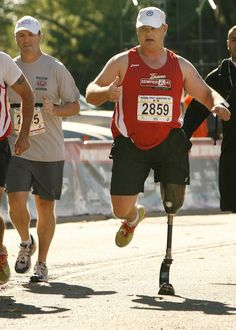 Gunnery Sgt. Spanky Gibson, right, finishes the Marine Corps Marathon 10K