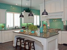 love the countertops and tiffany blue walls with white cabinets