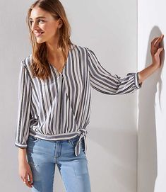ec6929589150a Shop LOFT for stylish women s clothing. You ll love our irresistible Petite  Striped Wrap Blouse - shop LOFT.com today!