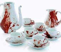 This tea set can be bought anywhere for cheap..add a little fake blood and you got yourself a *very* unsettling tea set :) perfect for any Halloween event...and will of course wash and be ready for every day re-use.