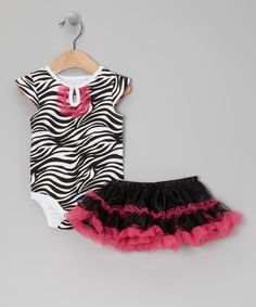 Pretty and practical, this set keeps cuties looking sweet and feeling comfy. Thanks to features like a button loop neck and snaps on bottom of the bodysuit, fitting in and making diaper changes is a breeze. Elastic on the tulle-embellished skirt rounds out the set in fabulous coordinated convenience. Includes bodysuit and skirtBodysuit: 100% cotton<...