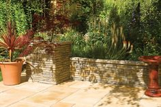 A low level wall surrounding your patio or paved areas helps keep any plants from spreading out, meaning more weeding!  #low #garden #walls