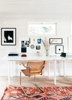 modern home office with white shiplap walls moroccan area rug and
