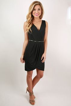 This faux wrap dress comes in three amazing colors, so don't hesitate before you snag each one! We love the zipper detail on the front that gives this otherwise simple dress an edgy vibe! Pair this super flattering dress with pretty heels and you'll have a look that is both comfortable and effortlessly chic! Features a zipper closure on the back.
