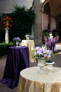 Elegant grecian urns are filled with purple freesia and fresh blueberries.