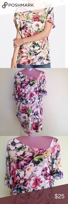 """Anthropologie Deletta Quoin Asymetric Top Size medium - approx. measurements laying flat- 20"""" W across chest - 29"""" L shoulder to hemline  95% rayon - 5% spandex - multi color floral ribbed stretch Knit - Asymmetric neckline skews left into a flattering wedge shape that elongates your neck  Excellent pre-owned condition with no stains, tears or odors Anthropologie Tops"""