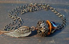 Hermes at Sunset - Messenger of the Gods - OOAK lampwork, stoneware, and copper wing pendant. by PreciousViolet on Etsy