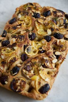 The one focaccia recipe you need. A golden crusted focaccia draped with whisper thin rounds of Meyer lemon, studded with black olives, and sliced almonds. Herb Recipes, Fruit Recipes, Baking Recipes, Bread Recipes, Savoury Baking, Bread Baking, Meyer Lemon Recipes, Focaccia Recipe, Pizza