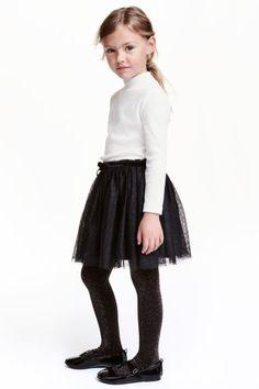 Saia brilhante em tule: Saia em camada dupla de tule com efeito brilhante e elástico brilhante na cintura. Forrada. H&M