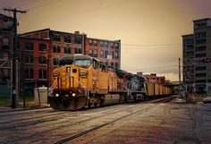 A westbound Union Pacific (UP) coal train passes through the historic Bottoms District of Kansas City , MO.