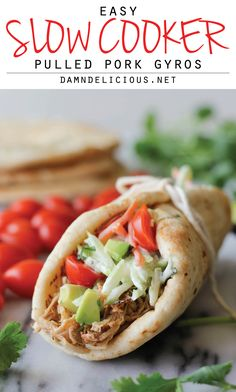 Slow Cooker Pulled Pork Gyros - Its time to dust off that crockpot with these tender pulled pork gyros!