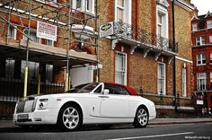 Rolls-Royce Phantom Drophead Coupe by Willem Rodenburg, via Flickr  Parking a Rolls next to the scaffolding for a construction site. I sometimes really think some people have more dollars than sense.