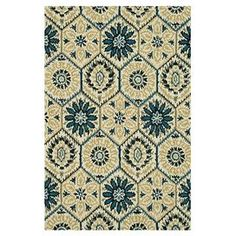 Hand-hooked wool rug with honeycomb motif.  Product: RugConstruction Material: 100% WoolColor: Ivory and navyFeatures:  HandmadeMade in India Note: Please be aware that actual colors may vary from those shown on your screen. Accent rugs may also not show the entire pattern that the corresponding area rugs have.