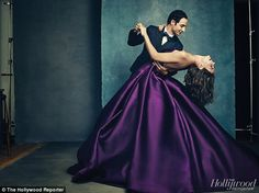 Exquisite dresses: In this dramatic image, Katie wears a stunning purple ballgown as the designer shows off some of his moves