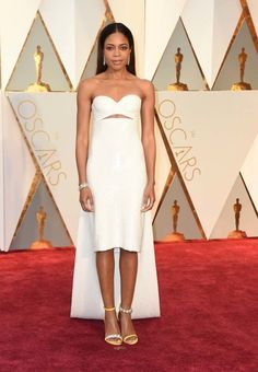 Naomie Harris in custom Calvin Klein. Check out those shoes!
