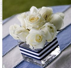 I like the use of the ribbon around the vase in this centerpiece.