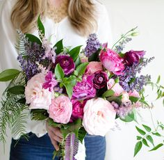 Bohemian purple and fuchsia loose bouquet by Gavita Floral