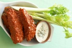 Buffalo wings can total to an astonishing 1,188 calories per serving. This recipe slashes the calorie total by more than 1/3.