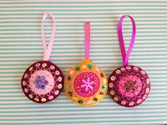 Set of 3 round beautiful Christmas ornaments. Hand embroidered and hand stitched. Measures approximately 2.5 in diameter.