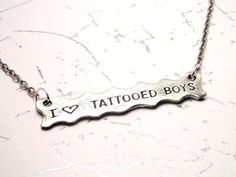 I love Tattooed Boys Necklace #Tattoos #Jewelry #Christmas  http://www.trendhunter.com