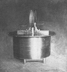 """A remotely excited receiving coil (""""Tuning Table"""") displaying sparks between plates."""