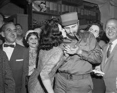 In 1959, Fidel Castro came to New York, hired a public relations firm, ate hot dogs, kissed ladies like a rock star, and held babies.     Here, Gladys Feijoo, 19-year-old Miss La Prensa of 1959, kisses Fidel Castro as he signs his autograph for her collection on April 22, 1959.