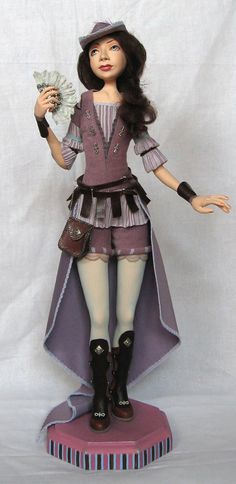 The art doll is called as Genrietta by GladOArt on Etsy,
