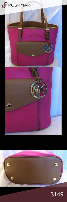 """Michael Kors Jet Set Nylon Large Pocket Tote Purse Michael Kors Jet Set Nylon Large Pocket Multifunction Tote   Excellent gently used condition Fabulous Fuchsia Pink with tons of compartments including a front wallet type with CC slots  All of my items are Guaranteed 100% Genuine I do not sell FAKES of any kind   Approx Measurements:   10""""  X   9.5""""  X 5.5 """"   Strap Drop:8""""  No Trades (S086) Michael Kors Bags"""