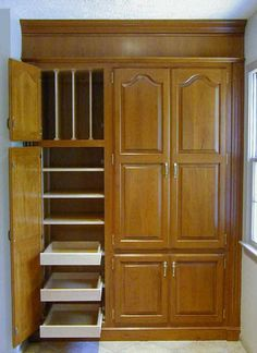 Pantry Cabinets  Love the tray organizer above