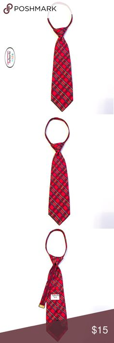 TALBOTS KIDS Boys Plaid Zip Tie EUC! This classic Talbots Zip Tie is designed with a plaid pattern of red, blue, green, & a hint of yellow. The back inside has a complimentary dotted navy pattern. The adjustable zipper allows custom fitting as needed. The zipper pull is accented with brushed hardware. Plaid trim on both sides of the zipper. Refer to images for approximate tie measurements. Perfect for any holiday or that special event in school. 100% silk. Imported;hand made. Dry Clean…