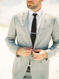 grey #suit | Photo: Lauren Kinsey  Read more - http://www.stylemepretty.com/2014/01/17/beach-elopement-wedding-inspiration/