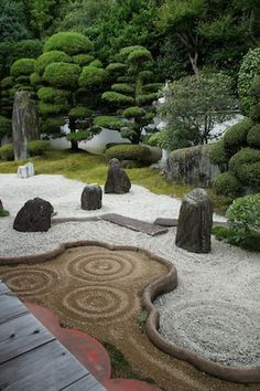 Zen garden,Kyoto - The Zen garden has 3 features, the sky, the land and the water. The water is sometimes represented by pebbles which are raked into ripple effects. the stones are the islands (the land) and the trees represent the sky or heavens. The gardens are quiet for people to sit and contemplate or meditate in quietness.
