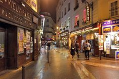 After Fall Shower, Lights of Restaurants Reflect on the Wet Pavement in St. Germain Neighborhood in Paris, France