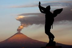 TIME Magazine's Best Pictures of the Week, May 2-June 1 - May 22, 2012. The view of a plume of ash during the activity of the Mexican volcano Popocatepetl seen from Puebla City, Mexico