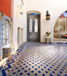LOVE this Moroccan-style Patio with a Tiled Fountain...