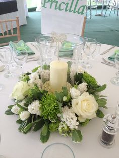 Green and white wedding inspiration flowers and flower green white floral arrangement with hurricane globe candle mightylinksfo