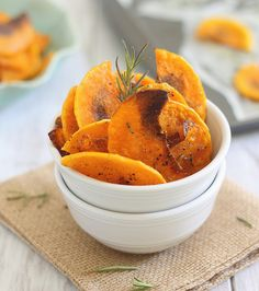 butternut chips 4 by Runningtothekitchen, via Flickr...the key is to boil thin slices in water for 2 minutes and pat dry before throwing them in 375 oven for 20 min.  Make sure to toss with EVOO, rosemary, salt and pepper.