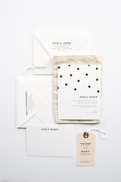 A sophisticated polka-dot baby announcement stationary set by In Haus Press.