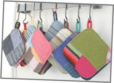 Potholders made from recycled wool scraps by Heidi Leugers of Reclaimed Wool .