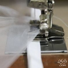 stitching on tulle can often pull right out, especially when gathering- TIP gather tulle in several layers (3-4) at once onto a strip of bias tape. The tape will remain flat while the tulle is stitched to it - use a gathering foot.