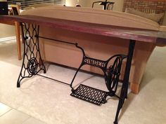Sofa table from old Singer sewing machine table legs.
