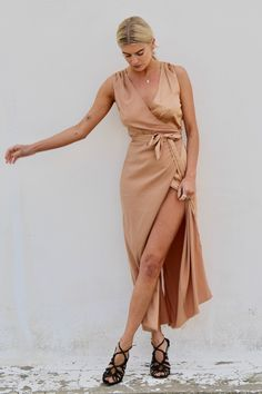 The Varley Gold is a sleeveless wrap dress, pair with sandals or dress up with heels or wedge sandals. Fabric: Polyester/ elastane SM: UK ML: UK Model is wears UK wearing SM Wrap Dress, Dress Up, Brown Outfit, Summer Collection, Wedge Sandals, Pairs, Fabric, Model, Gold