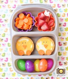 sliced baby carrots, sliced plots, crackers with cheese and carrot noses & feet, mini easter eggs filled with surprises: fruit, crackers, and 1 had a special chocolate treat.
