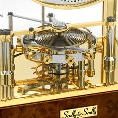 Close-up view of the symmetrical co-axial escapement (George Daniels' invention) to the Meridian Coaxial Gold-Plated Clock. The movement features a special version of Dr. Daniels' co-axial escapement,