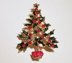 Vintage Christmas tree brooch •Green enamel branches, red enamel balls with crystal rhinestone star at top •Gold tone setting, unsigned •2.5