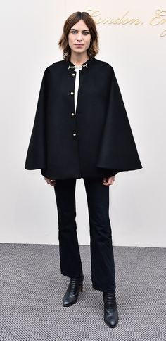 Alexa Chung wearing Burberry outerwear to arrive at the womenswear show