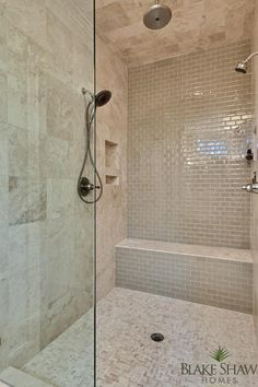 Taupe subway tile light grout accent wall in master shower