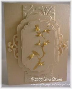 Cremas y oro El uso de etiquetas Spellbinders